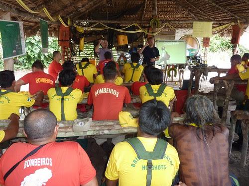 Fire brigades in the Brazilian Amazon listen to Scott Dehnisch, a U.S. Forest Service employee.  Photo courtesy of Forrest Behm.