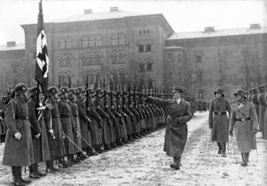 Nazi Re-enactors: A photo from the German government's national archives shows Adolf Hitler reviewing the SS Leibstandarte A.H. combat unit in December 1935. A re-enactor group's portrayal of the unit drew the ire of one U.S. military veteran, and has caused the Fairfax County Park Authority to scrap the World War II re-enactment planned for Sully Historic Site in 2016. - o.Ang.