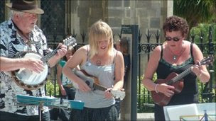 Members of the Norwich Ukulele Society outside the Forum