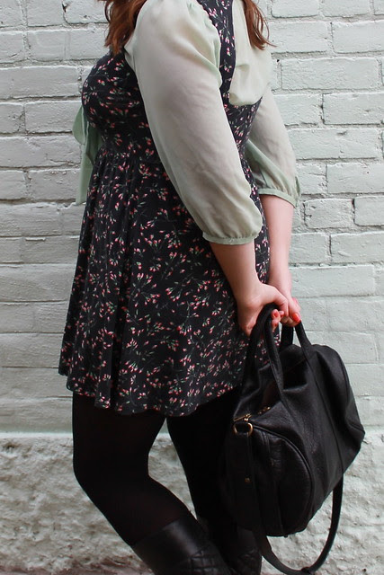 Rosemint outfit: black tights, black quilted boots, rosebud open-back dress, mint green sheer bow-tie blouse, studded-bottom bag, leather motorcycle jacket
