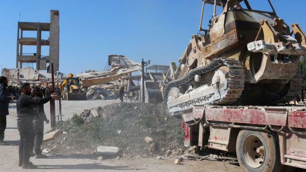 A bulldozer in the wreckage of an MSF hospital in Maarat al-Numan, Syria