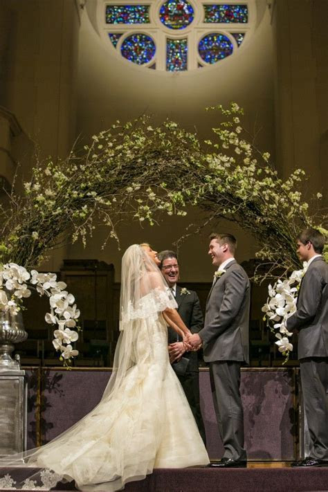 A romantic church wedding with a delicate arch and