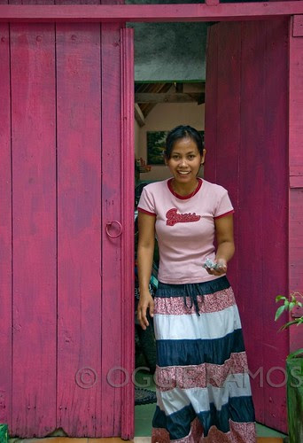 Indonesia - Solo Woman by the Pink Door