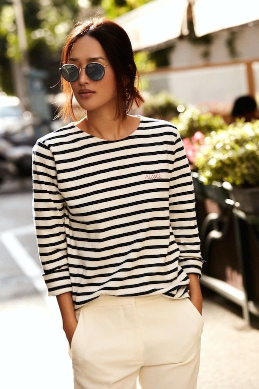 Le Fashion Blog Parisian Style Low Bun Mirrored Round Sunglasses Striped Tee Shirt Cream Trousers Via Gary Pepper