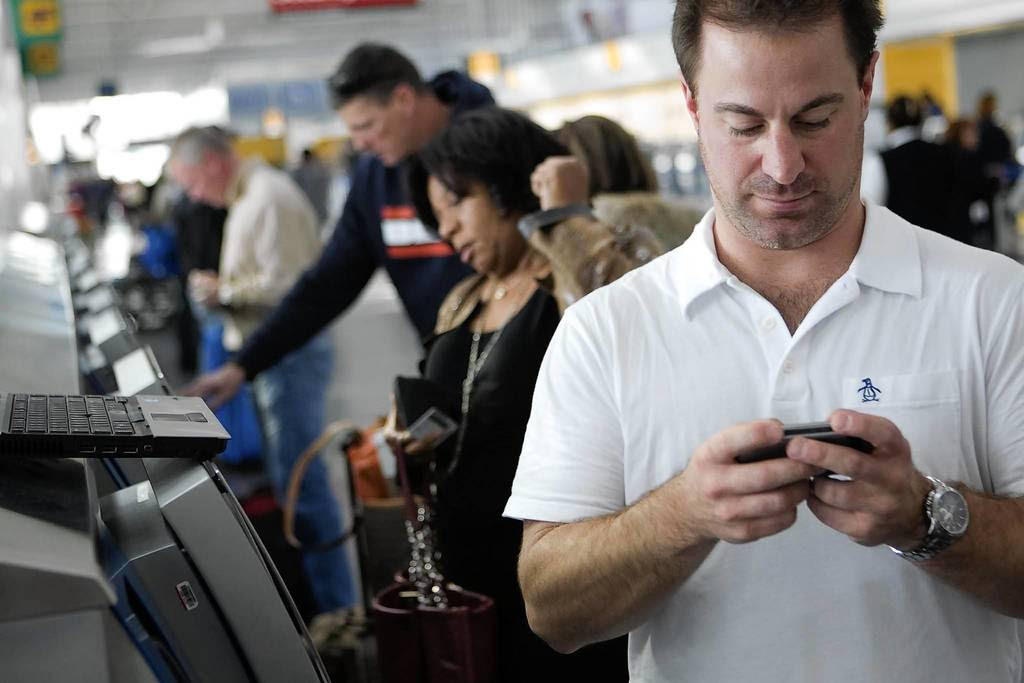 Doug Austin, 36, hurries to reschedule a flight in the United Terminal of O'Hare International Airport. His flight to the southwest was delayed because the plane coming from New York was stranded. He needed a flight that would get him there faster.