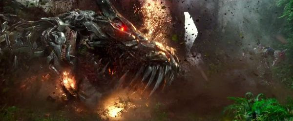 Grimlock is knocked into the ground by Optimus Prime in TRANSFORMERS: AGE OF EXTINCTION.