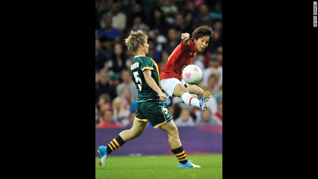 South Africa's Janine Van Wyk, left, and Mana Iwabuchi of Japan go after the ball during the women's football first round match Tuesday at Millennium Stadium in Cardiff, Wales.