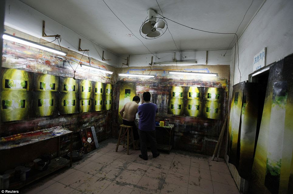 A painter prepares to work on decorative paintings: The economic crisis has hit the purchashing power of many of the district's Western customers