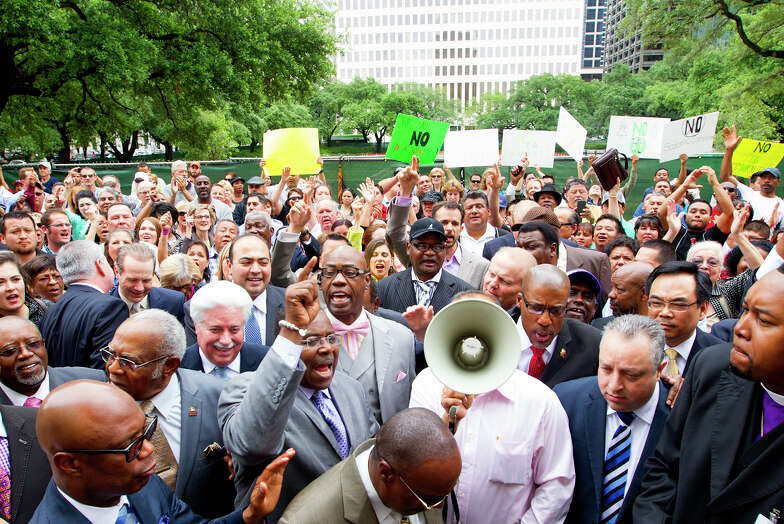 Voices and Bibles are raised Tuesday after a the mayor announced a compromise to her proposed nondiscrimination ordinance.