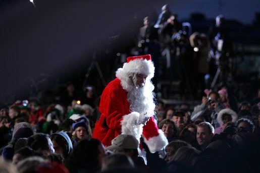 Santa goes into the audience to sing a song , Thursday evening, Dec. 1, 2005, during the Pageant of Peace and the lighting of the National Christmas Tree on the Ellipse in Washington. White House photo by Paul Morse
