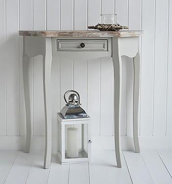 Add driftwood effect pieces of furniture with aged looking wood. What more reminds you of the beach as collecting pieces of wood washed up on the shore!