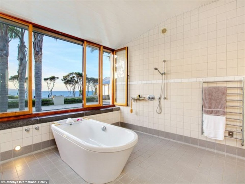 Haven: Sothebys Matt Finnegan told MailOnline his clients might not be planning to move permanently to New Zealand, but 'still want to have somewhere to run to in times of trouble'. This bathroom's views are not the only thing to recommend this home - it also has an olive grove