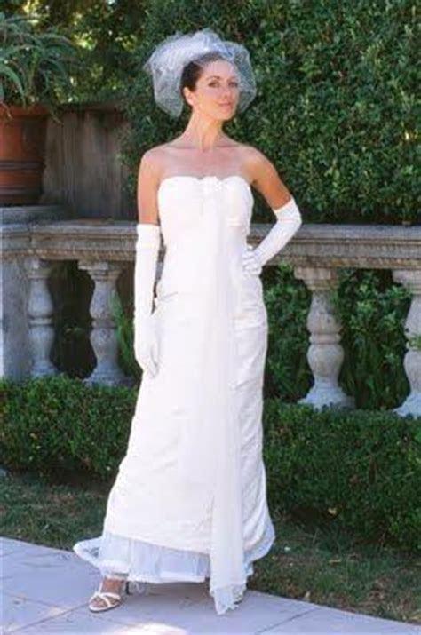 Beautiful white strapless wedding dress with vertical sash