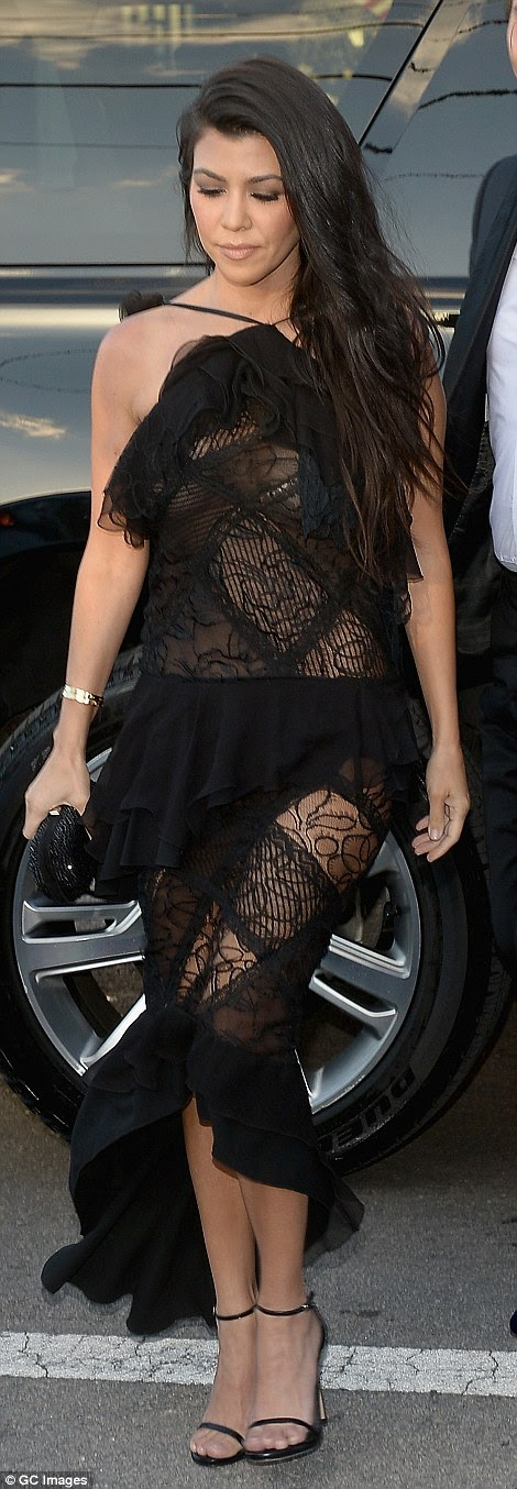 The transparent lace showed off the reality stars thighs and revealed her flesh coloured bra