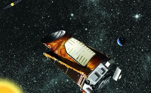 An artist's concept of the Kepler telescope in space.