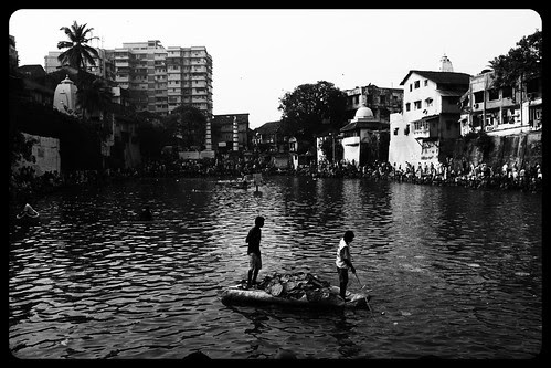 Pitru Paksh  Keeping The Banganga Clean Of Puja Leaves by firoze shakir photographerno1