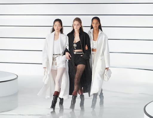 Avatar of Kaia Gerber and Gigi Hadid give us girl gang vibes at Chanel's PFW show