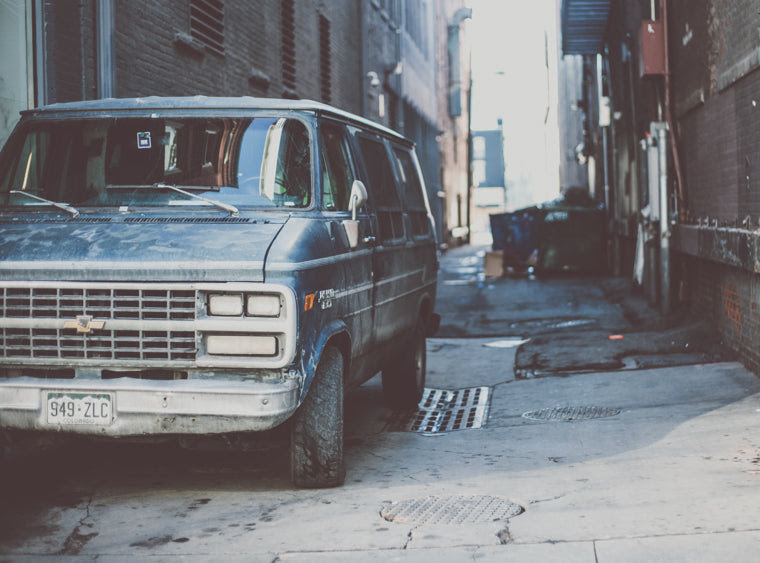 photo of downtown denver alleyway with old van