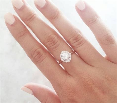 Why does a woman wear her engagement ring on her right