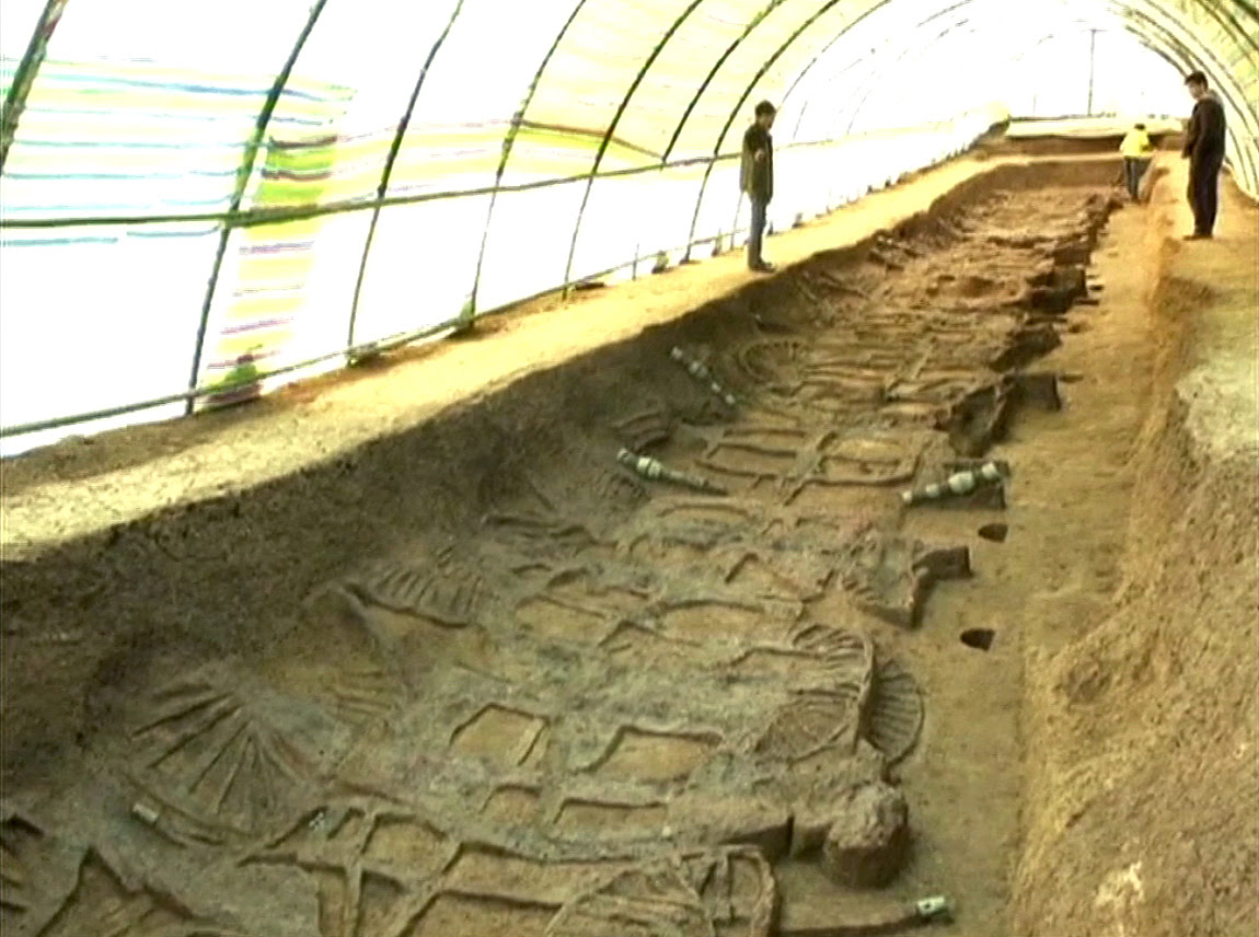 The chariots lie side-by-side in a long pit measuring 33m by 4m
