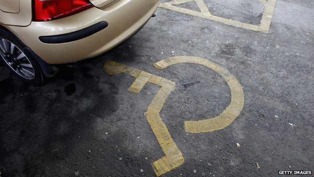 Car parked in disabled parking space