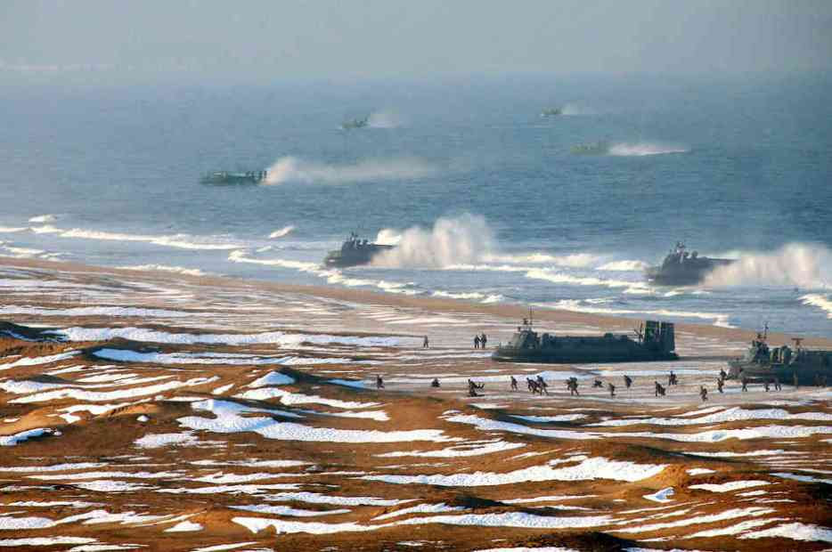 North Korea issued this photo last week, which appears to show a flotilla of landing craft assaulting a beach. Upon closer inspection, many of these vessels are superimposed on the image.