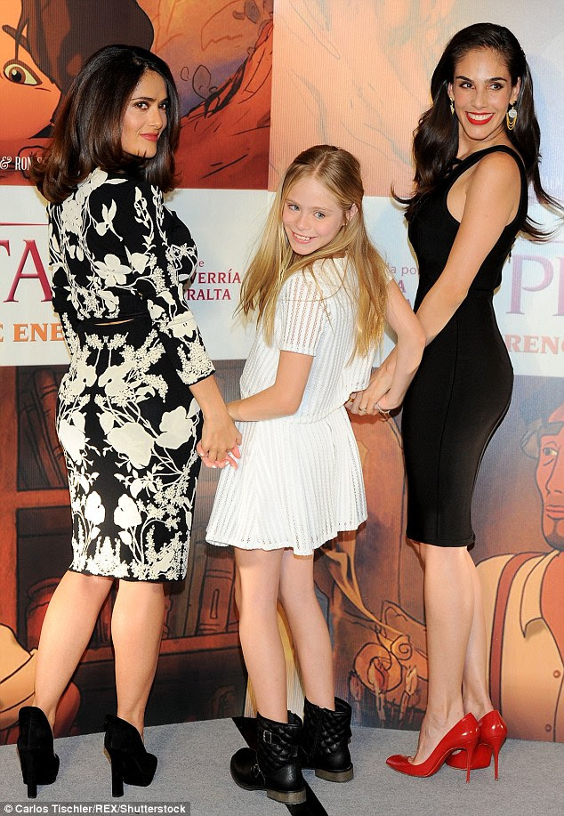 Having some fun: All three actresses struck a playful over-the-shoulder pose