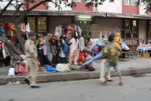 The Mumbai Cop Is Used To Shocks On Mumbai Heartless Streets by firoze shakir photographerno1