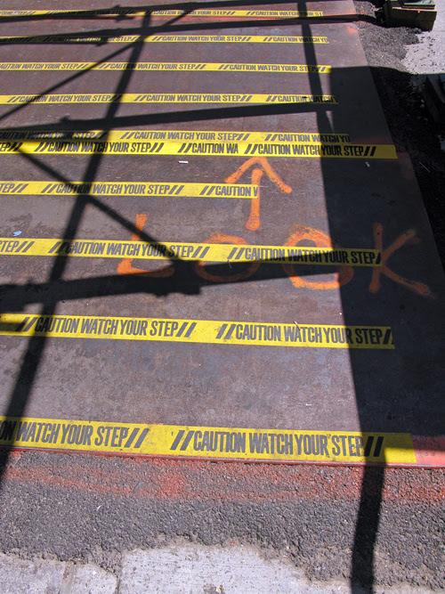 CAUTION message on sidewalk, Manhattan, NYC