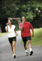African American man and woman walking