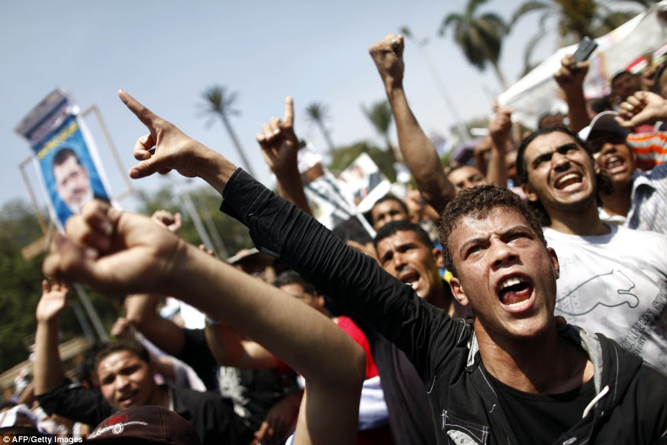 Aggression: Muslim Brotherhood supporters shout religious and political slogans during a protest near Cairo University