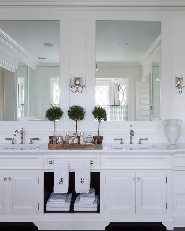 Bathroom Cabinet Design Ideas. Master Bathroom Cabinet. This double vanity includes both concealed and display storage spaces. Its mirrors reflect the view at the bay window behind. #Bathroom #MasterBathroom #BathroomCabinet