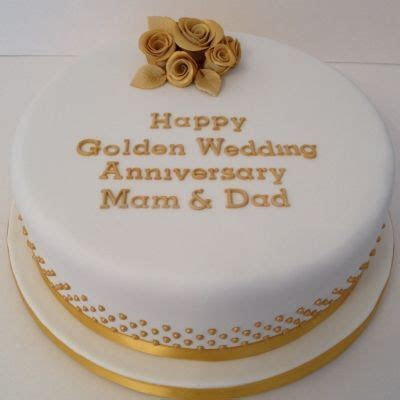 Golden Wedding Anniversary cake decorated with roses and