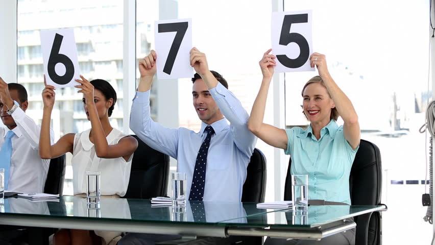Image result for judges holding up low scorecards