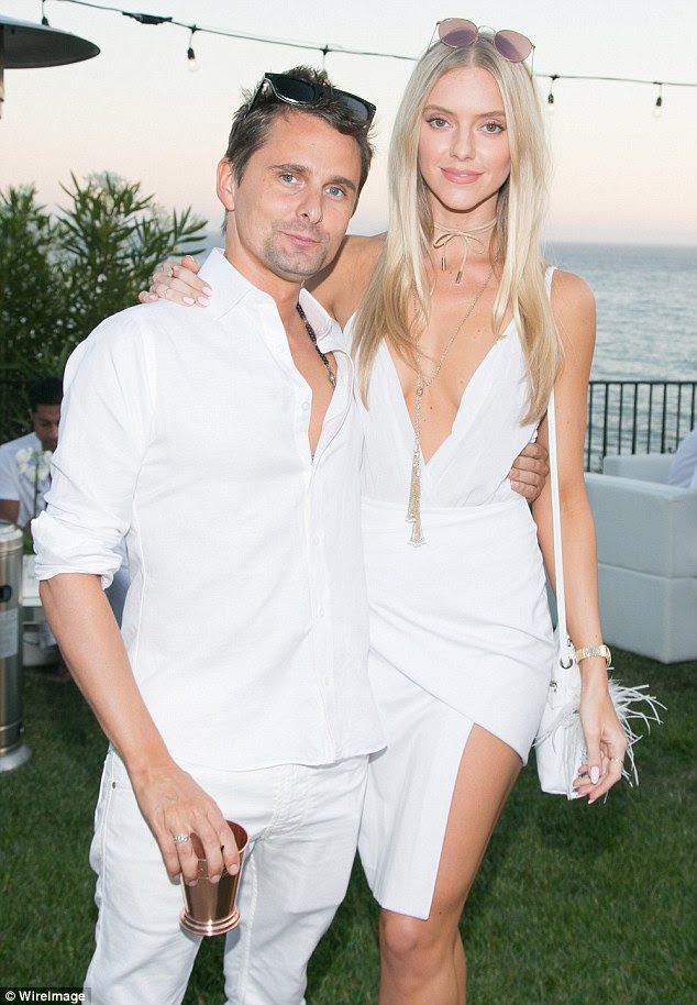 He's found his muse: Matt Bellamy, 38,  whisked his  girlfriend Elle Evans, 26, on a romantic date night as they attended the annual Treats! Magazine white party on Saturday
