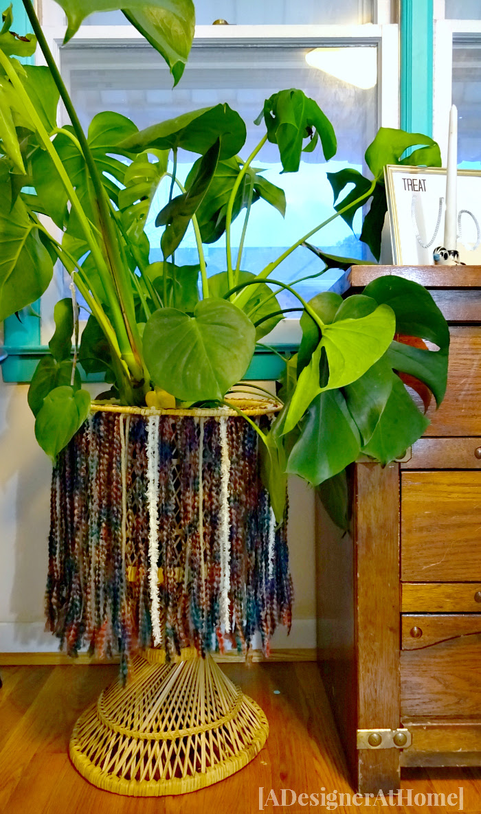 jungalow style bohemian decor diy yarn fringe on wicker plant stand