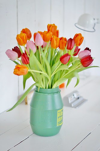 orange, pink & red tulips by wood & wool stool