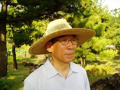 Dad wearing a straw hat in Halim Botanical Garden, Jeju