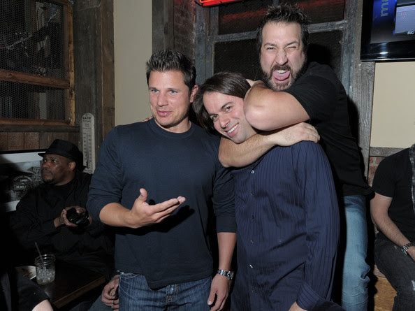 Singers (L) Nick Lachey and Joey Fatone (R) and owner of  Brother Jimmy's Jeff Lebowitz attend the Brother Jimmy's Union Square  grand opening hosted by Lachey at Brother Jimmy's on March 10, 2010 in  New York City.