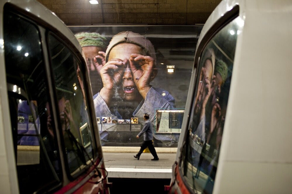 An exhibition of photographs by National Geographic photographer Reza Deghati is found at the Luxembourg metro station.