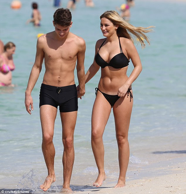 Bikini body: Sam showed off her killer curves in a skimpy black two-piece as she and Joey enjoyed a spot of winter sun