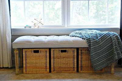 Storage baskets under a bench for a makeshift window seat. / For ...