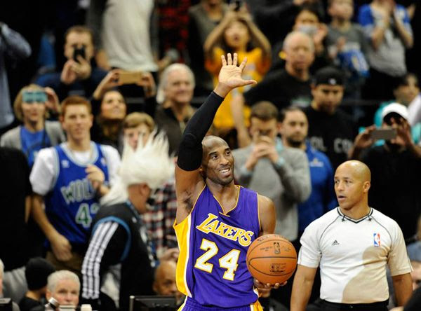 Kobe Bryant waves to the Minnesota crowd after making a free throw that helped him surpass Michael Jordan on the NBA's all-time scoring list...on December 14, 2014.