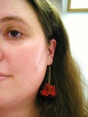 Phoenix Boa Earrings modeled