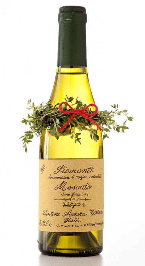 A mini wreath dresses up a wine bottle to give as a hostess gift.