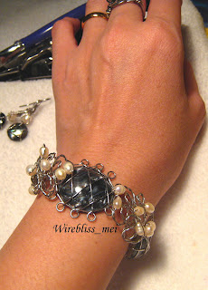 Wire Wrapped Shell Brangle around wrist