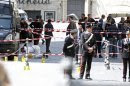 Carabinieri police stand as they patrol around the area where gunshots were fired, in front of Chigi Palace, in Rome