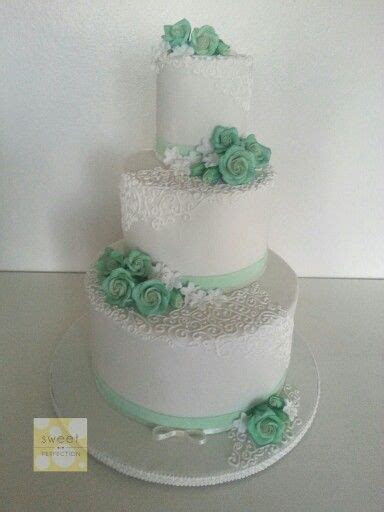 3 tier off white wedding cake with vintage feel. Mint