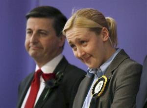 Paisley and Renfrewshire South constituency winner Mhairi Black of the Scottish National Party (SNP) and Labour's Douglas Alexander react at the Lagoon Leisure Centre in Paisley, Scotland.