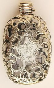 though this board is mostly about wearable sterling silver, this antique silver overlay flask is sort of wearable?